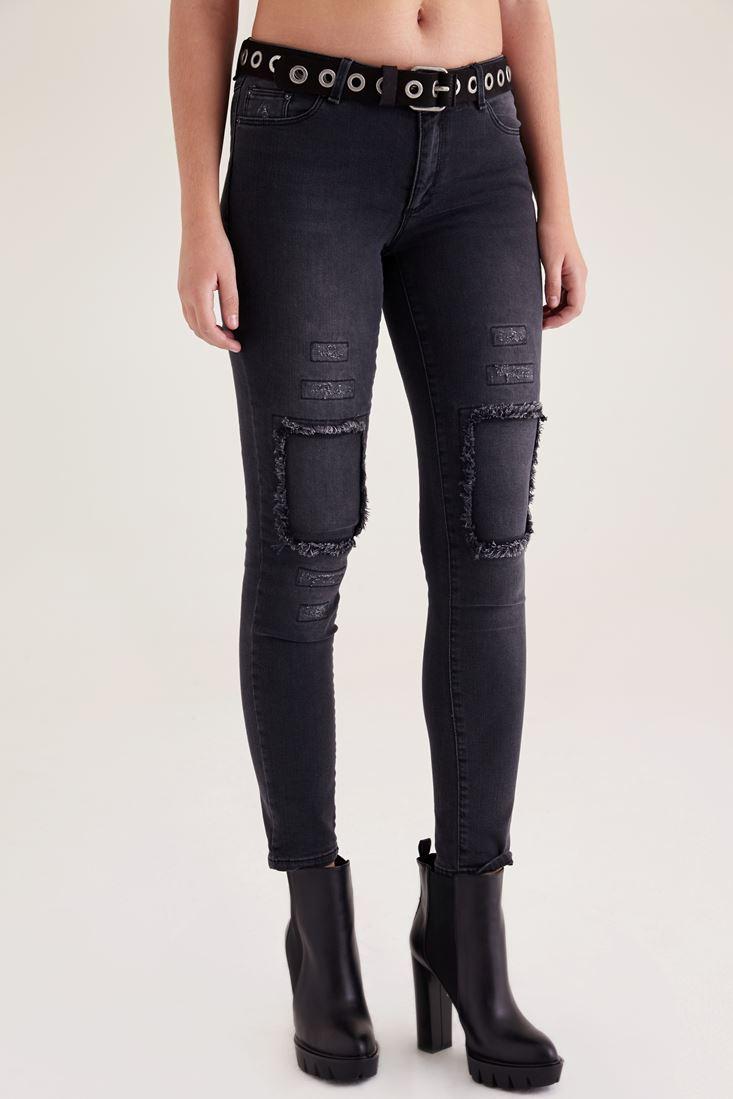 Black Torn jeans knee aging
