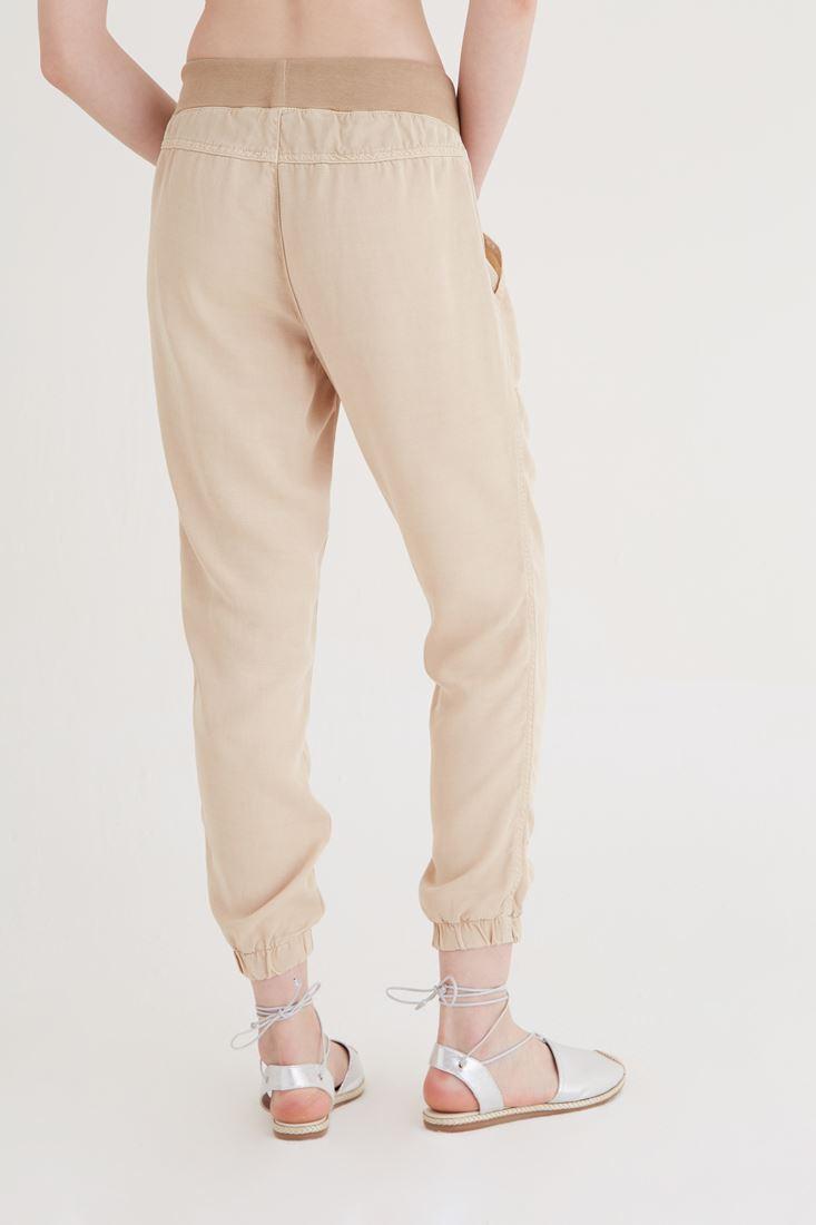 Bayan Krem Paçaları Lastikli Pantolon
