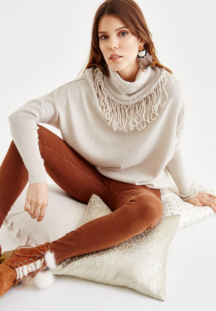 Cream Pullover with Tassel and Neck