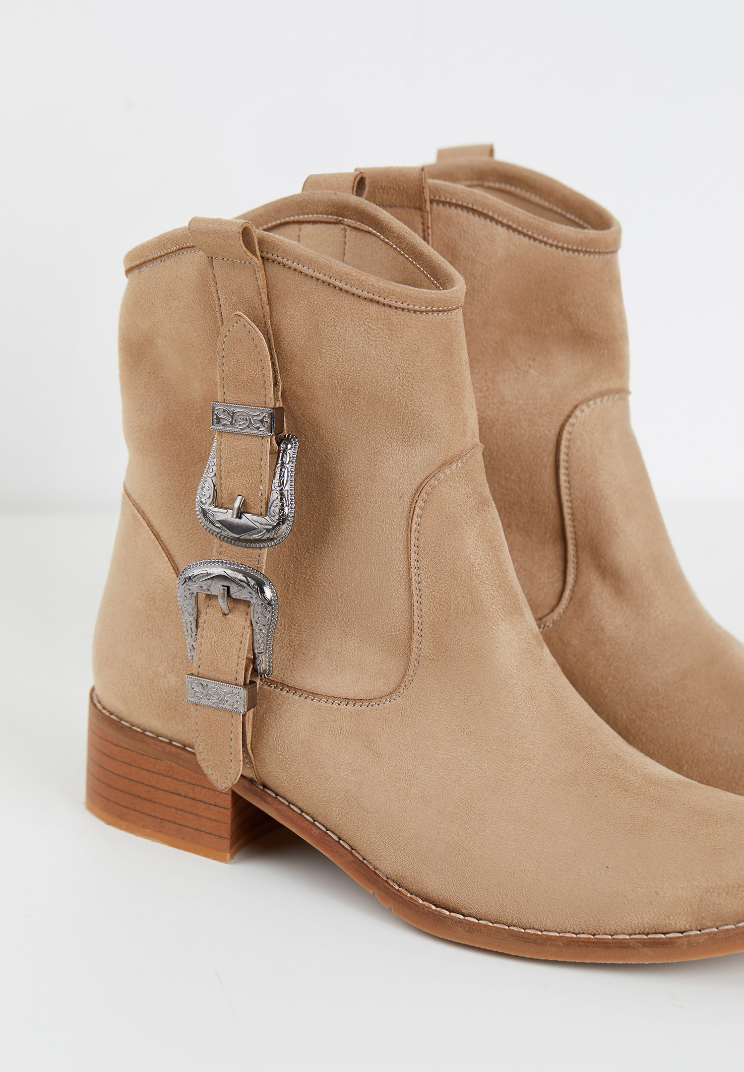 Women Cream Boots with Buckle Detail