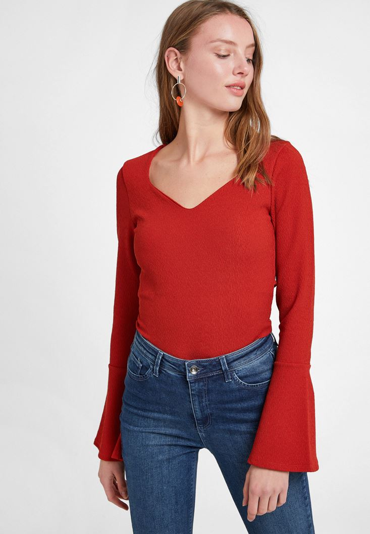Red V Neck Textured Blouse