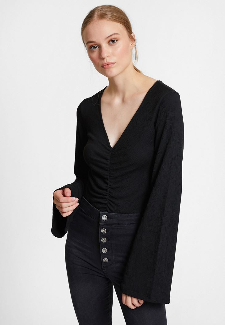 Black Smocked Blouse with Flared Sleeve