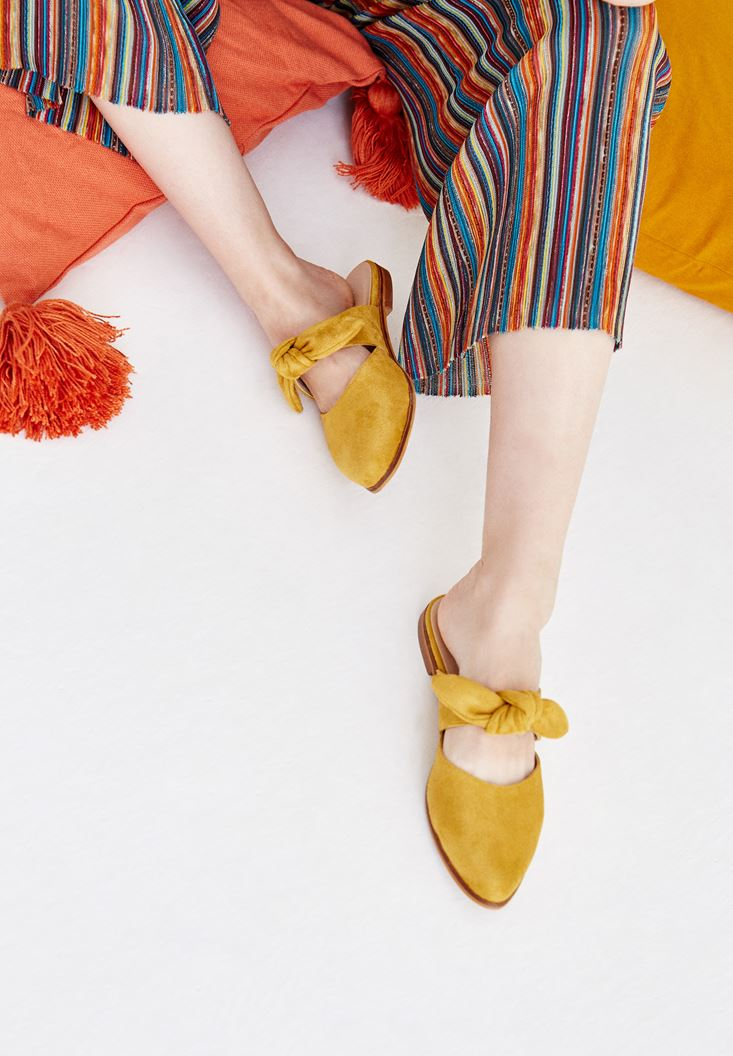 Yellow Slippers with Binding Details