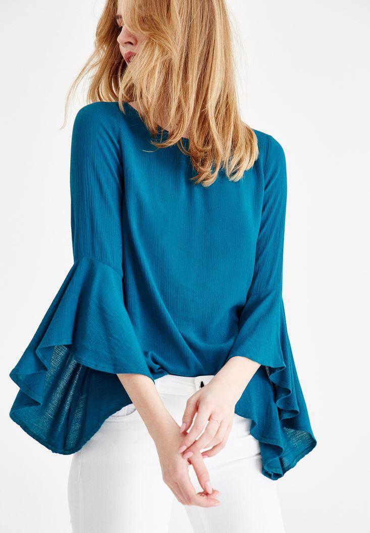 Mavi Kolları Volanlı Sırt Detaylı Bluz