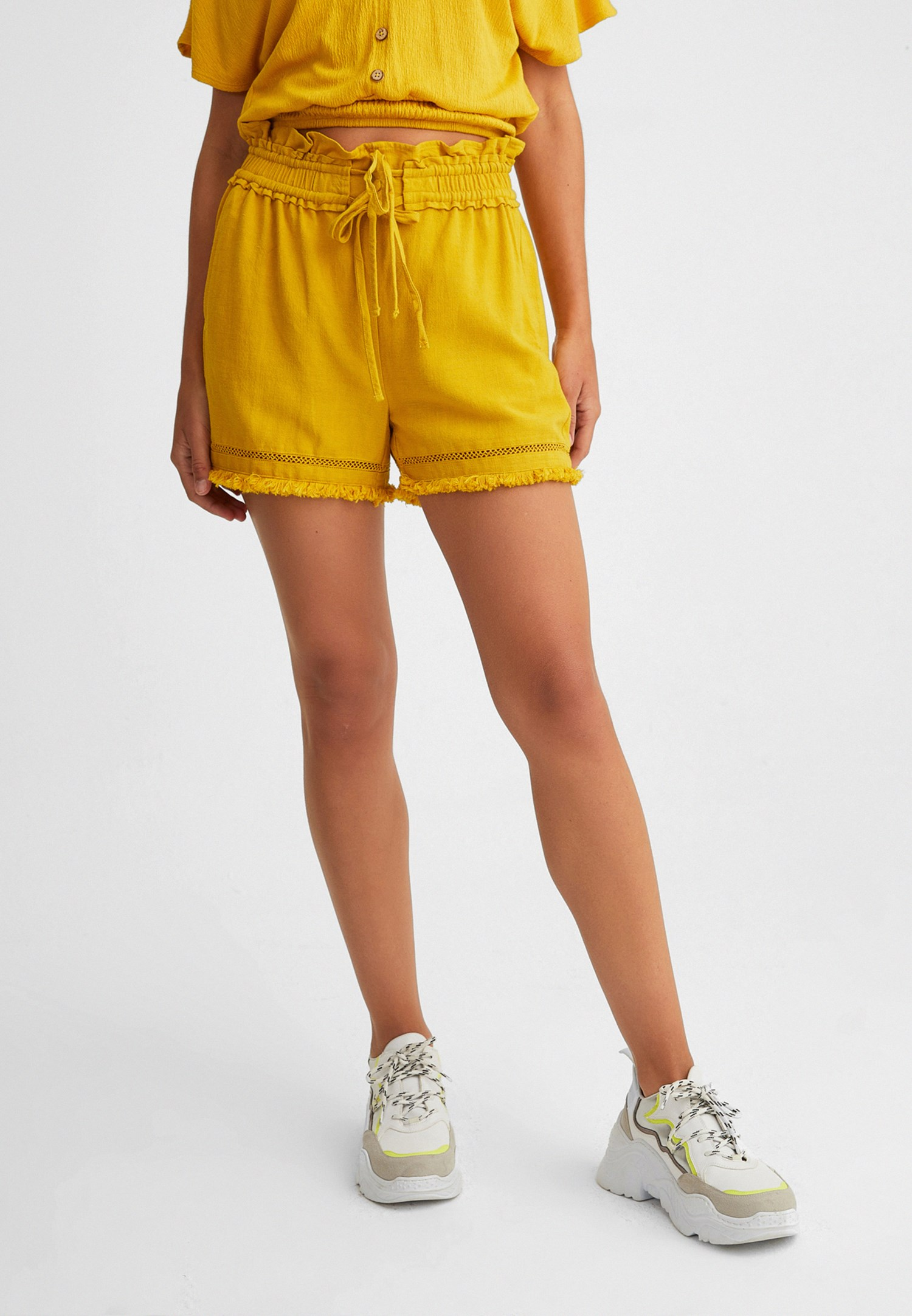 Women Yellow Belted Shorts with Fringe