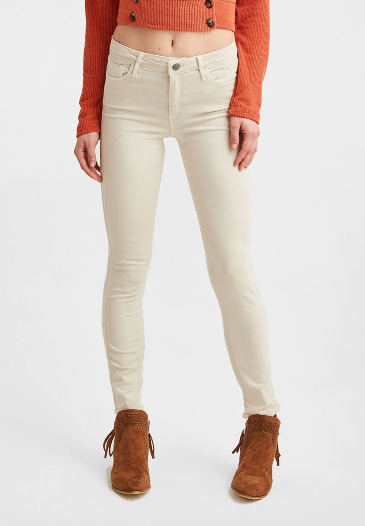 Cream Mid Rise Skinny Pants